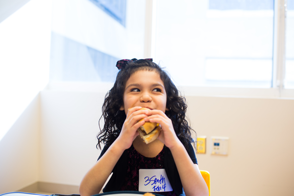 Girl Eating Hamburger, CHOC Feeding Program