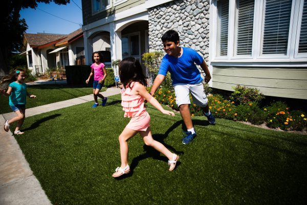 kids-playing-tag-front-of-house