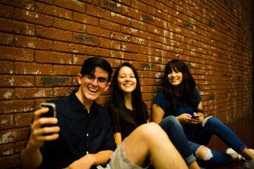 three-teens-taking-selfie