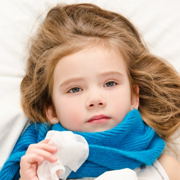 Young girl in bed with the flu