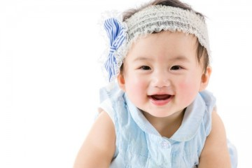 Happy baby girl with headband