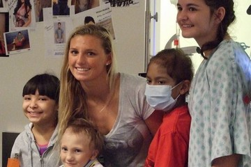 Lakey Peterson posing with patients in Seacrest Studio