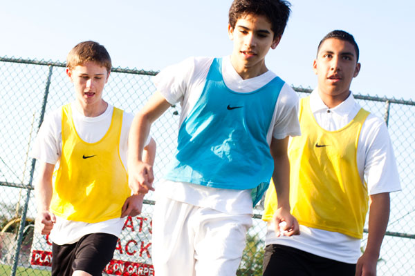 Three boy soccer players