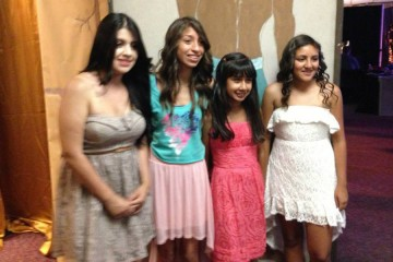 Four teen girls dressed up for the Oncology Prom