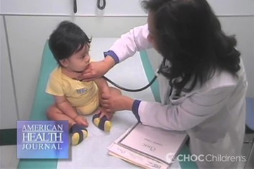 Toddler being examined by Dr. Morchi in clinic