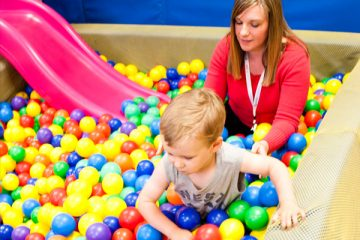 Young boy in ball pit