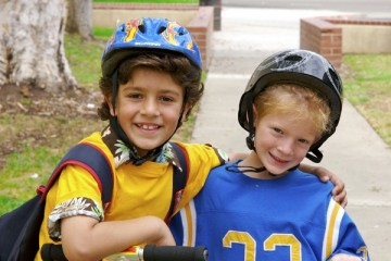Two young boys wearing helmets