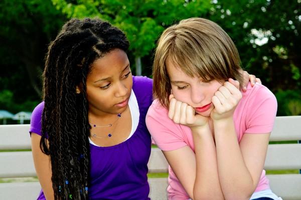 Girl helping her friend