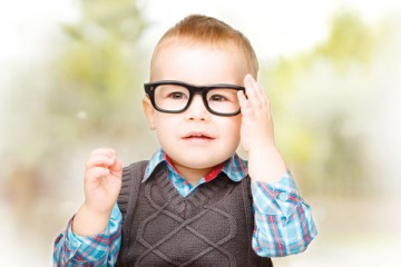 Young toddler boy wearing glasses