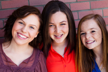 Three smiling teen girls