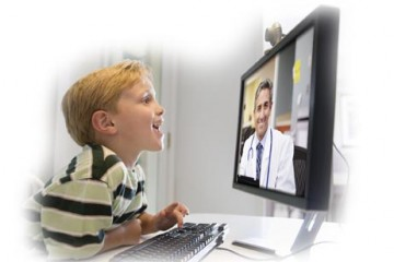 Boy engaged with physician via teleconference