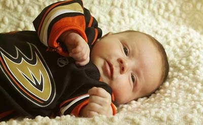 Infant wearing Ducks jersey