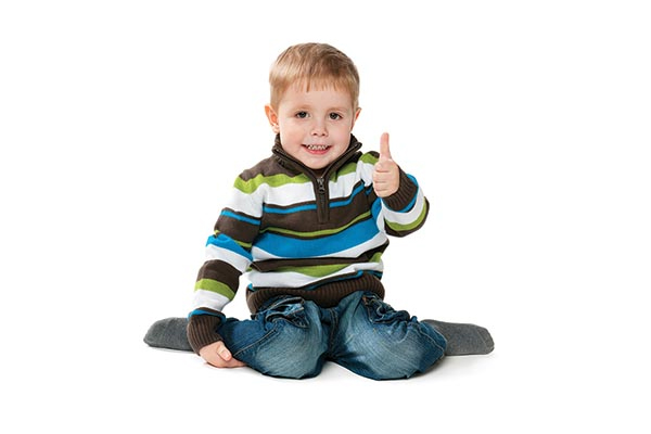 Young boy giving the thumbs up sign