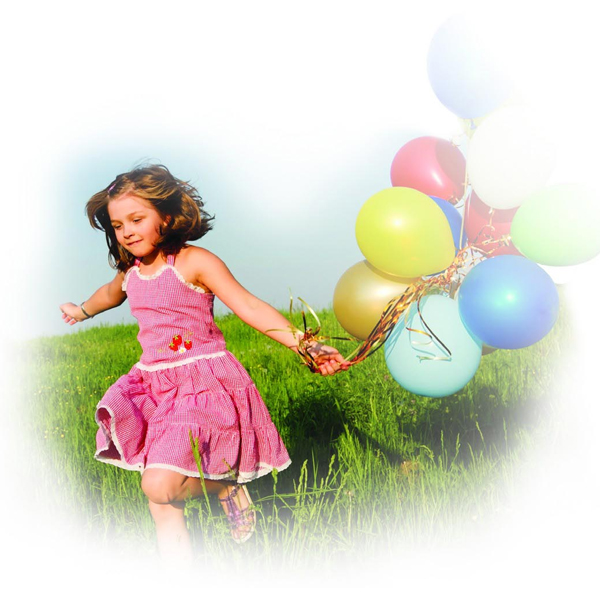 Girl running outside with colorful balloons