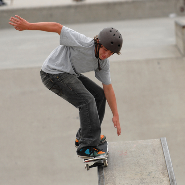 Boy on a skateboard wearing a helmet