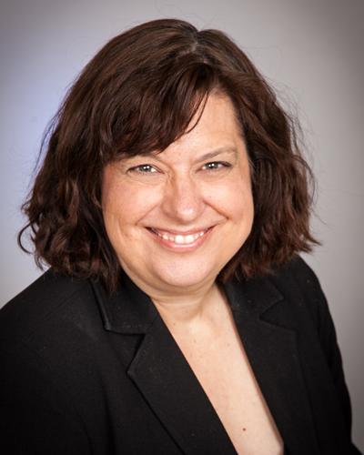Dr. Heather Huszti