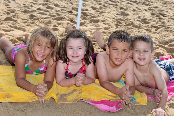 Young kids on the sand at the beach