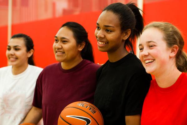 Smiling teen girls on a basketball team