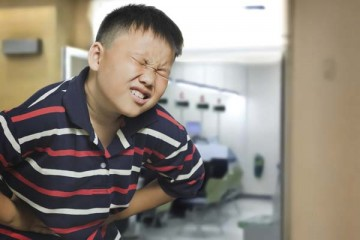 Boy experiencing severe pain