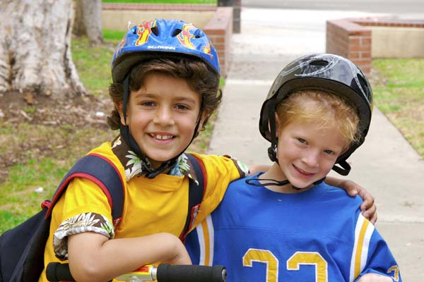 Two boys wearing helmets for concussion protection
