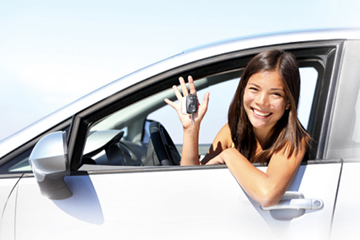 Girl in driver's seat of car holding the car keys