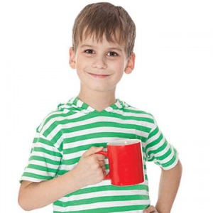 Young boy holding a cup of coffee