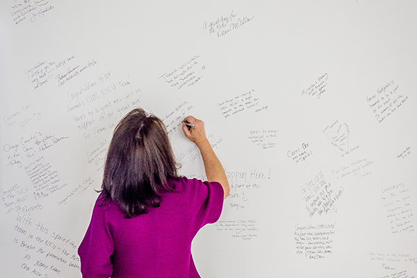 Kim Cripe signing on the wall