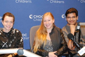 Three teens in Seacrest Studio fro podcast