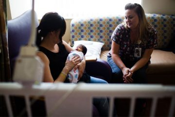 private NICU room with mom, baby and nurse