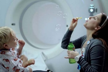 Child life specialist blowing bubbles
