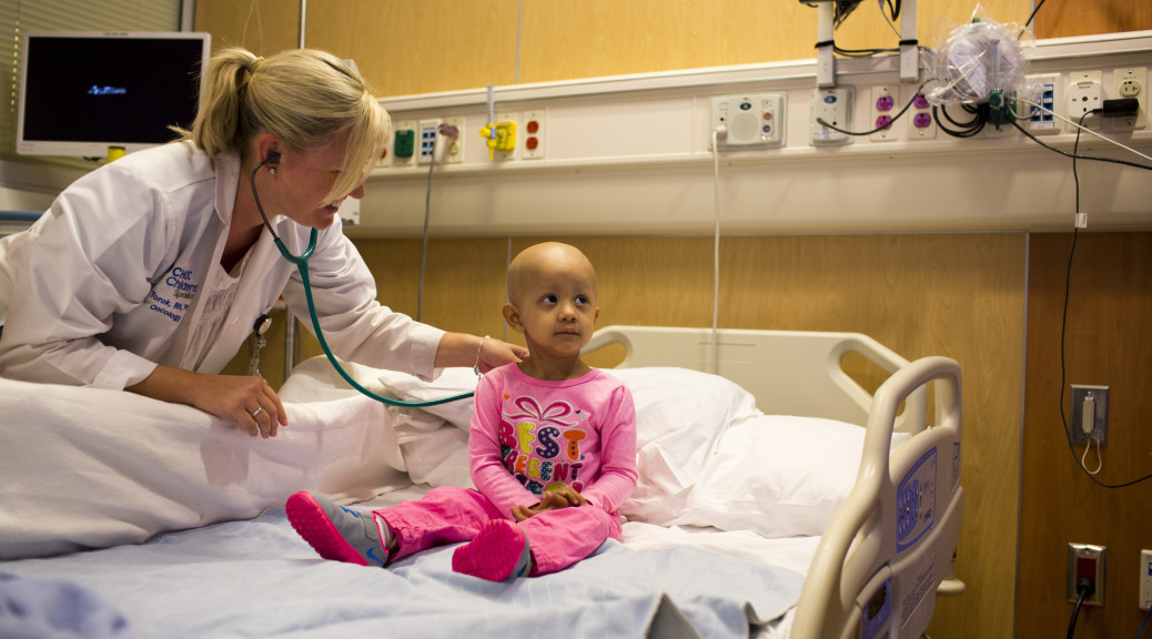 Physician at bedside of cancer patient
