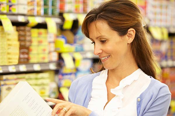 Woman looking at food labeling on package