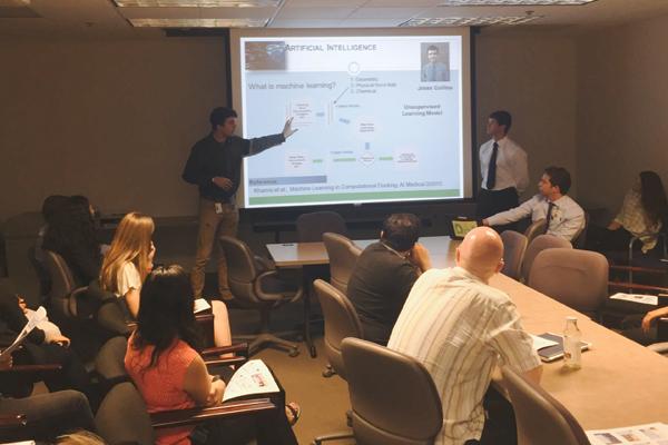 MI3 interns giving presentation