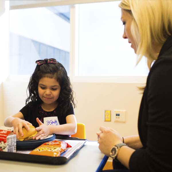Clinical dietitian giving young girl lessons in good nutrition