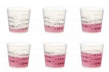 Medication cups showing dosage levels