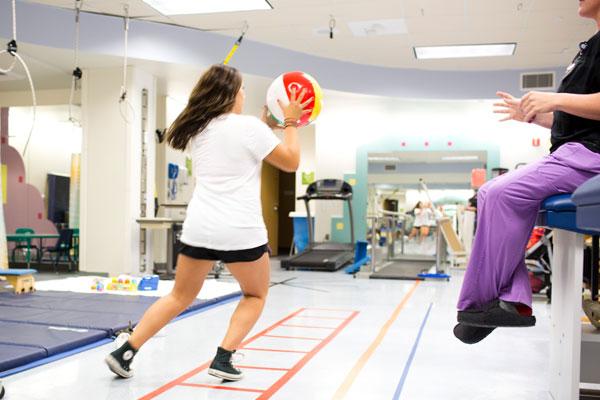 Teen girl in sports rehabilitation