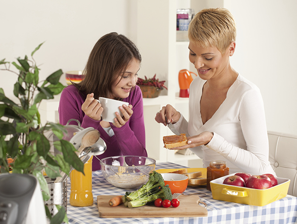 Mom and daughter preparing a meal