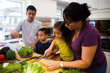 Family making a salad