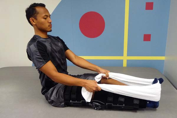 acl-exercises-long-sitting-towel-calf-stretch-2