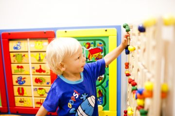 Young boy playing with wall games