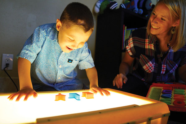 Boy and mom in playroom