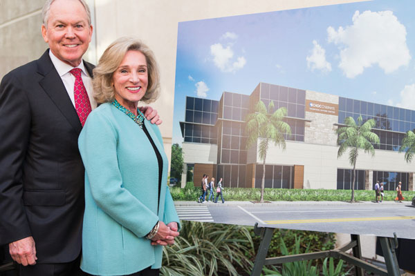 Bill Thompson and wife next to rendering of Autism Center