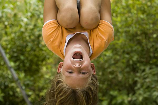Specialty Services - healthy girl hanging upside down