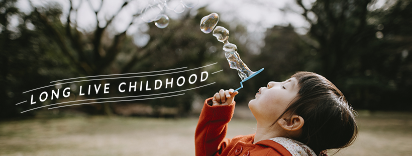 Girl blowing bubbles - Long Live Childhood