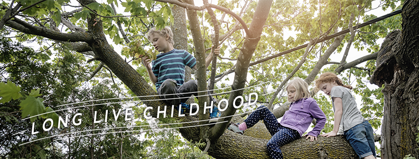 Kids climbing a tree - Long Live Childhood