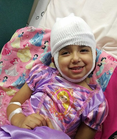 Smiling girl with bandages on her head