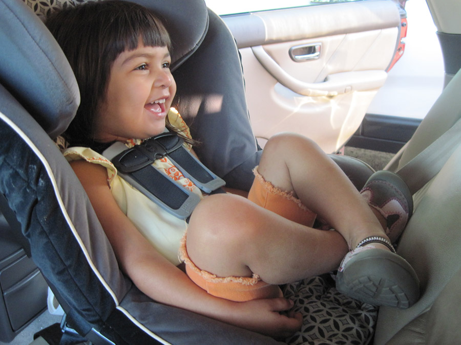 Smiling child in reverse facing child seat