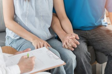 Parents talking about prognoses with physician