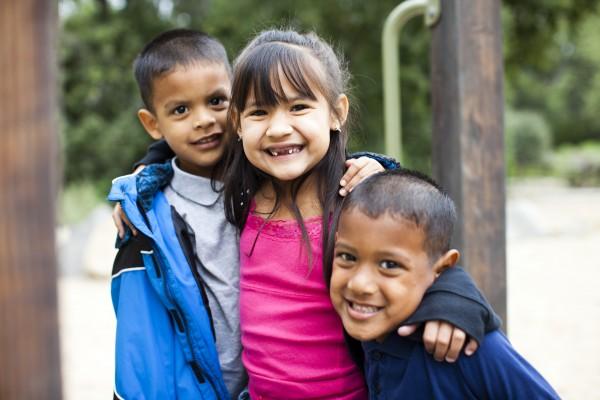 Three kids on the playground