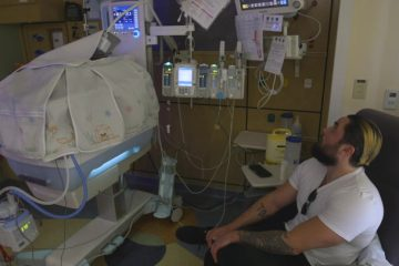 Dad at bedside of child in NICU